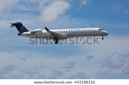 MIAMI - June 26, 2016: Canadair Regional Jet United Express landing at the Miami International Airport. United is a major US airline.