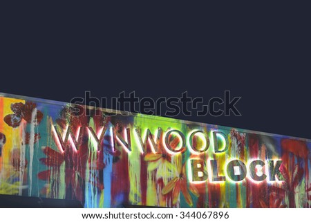 MIAMI - OCTOBER 28: Stock image of the Wynwood Block sign at Wynwood Miami which is an artistic neighborhood with art murals on building walls and tourist destination October 28, 2015 in Miami FL - stock photo