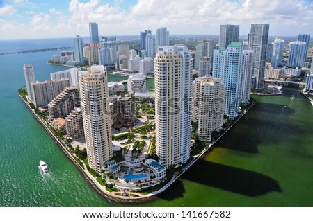 MIAMI - OCTOBER 25 : The Miami River on october 25, 2010. It drains out of the Everglades and runs through the Downtown and the city of Miami and is 5.5-mile (8.9 km) long. - stock photo