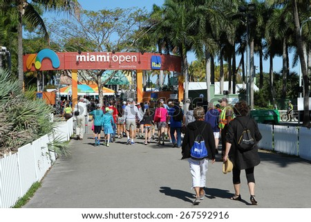 Miami Open, Key Biscayne, Fl, March 29, 2015:  Tennis enthusiasts  walk towards the Miami Open entrance to enjoy a full day of  competition.  - stock photo