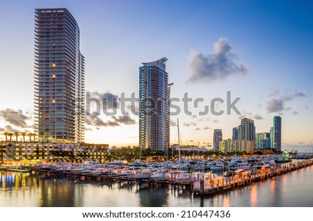 Miami south beach street view with water reflections at night and the marina - stock photo