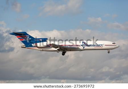 MIAMI, USA - April 29, 2015: Classic Boeing 727 cargo by Amerijet landing at Miami International Airport.  - stock photo