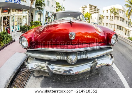 MIAMI, USA - AUG 18, 2014 : Ford Vintage car parked at Ocean Drive in Miami Beach, Florida. Art Deco architecture in South Beach is one of the main tourist attractions in Miami - stock photo