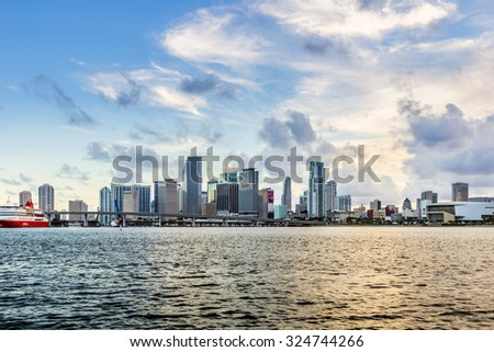 MIAMI, USA - AUG 28, 2014: Miami city skyline panorama at dusk with urban skyscrapers and bridge.Miami is the 44th most populated city in the USA with a population of 417 tsd. - stock photo