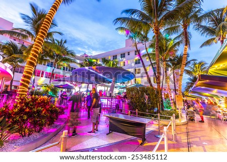 MIAMI, USA - AUG 3, 2013: Night life in the clevelander bar at Ocean drive in Miami, USA. Night-Life in South Beach is one of the main tourist attractions in Miami. - stock photo