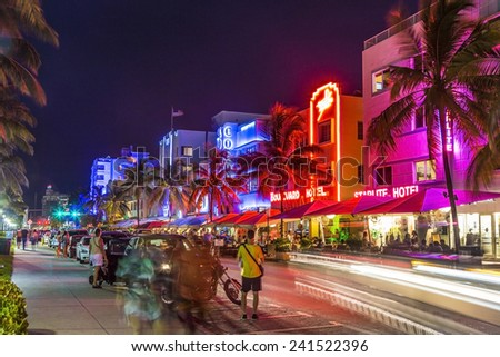 MIAMI, USA - AUG 19, 2014: peope visit Ocean drive buildings in Art deco style in Miami, USA. Art Deco district architecture is one of the main tourist attractions in Miami. - stock photo