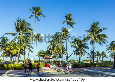 MIAMI, USA - AUG 23, 2014: people walk along the promenade at ocean drive at Miami, USA. Ocean drive is the most popular street in South Beach. - stock photo