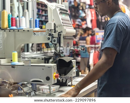 MIAMI, USA - AUGUST 29, 2014 : Cap on embroidery machine in a store on August 29, 2014 in Miami. - stock photo