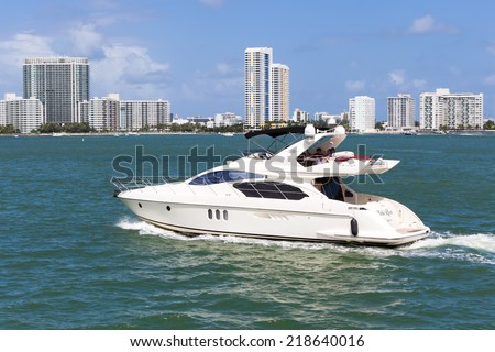 MIAMI,USA - AUGUST 26, 2014 : Small private yacht sailing in Biscayne Bay - stock photo
