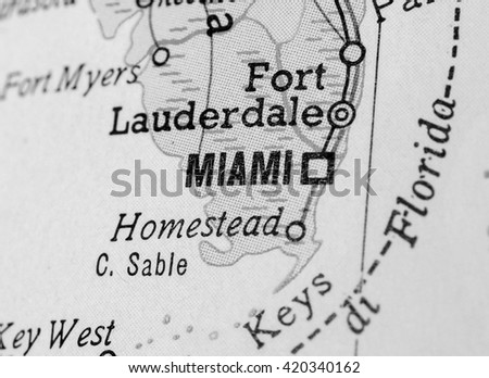 MIAMI, USA - CIRCA APRIL 2016: Detail of a map of the city with selective focus on town name in black and white - stock photo