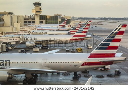 MIAMI, USA - JUNE 10: Panoramic view of the Miami Airport in Miami, Florida, USA showcasing some of its docks with lots of planes loading and unloading passengers on a warm afternoon on June 10, 2014. - stock photo