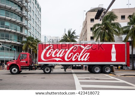 MIAMI, USA - MARCH 21, 2016: Coca Cola Truck (Coke) on the street. Coca-Cola is a carbonated soft drink, produced by The Coca-Cola Company of Atlanta, Georgia. - stock photo