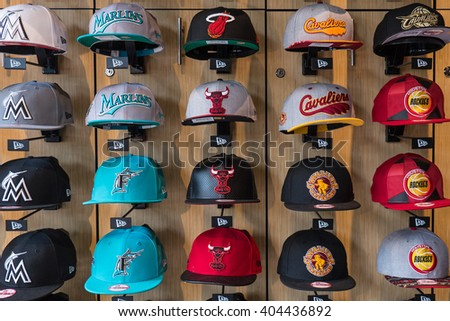 MIAMI, USA - MARCH 21, 2016: Different baseball caps displayed inside Sports store. - stock photo