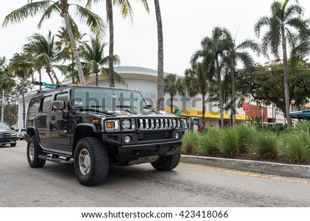 MIAMI, USA - MARCH 21, 2016: Hummer H2 Black on the street. The Hummer H2 was the second vehicle in the Hummer range after the H1.