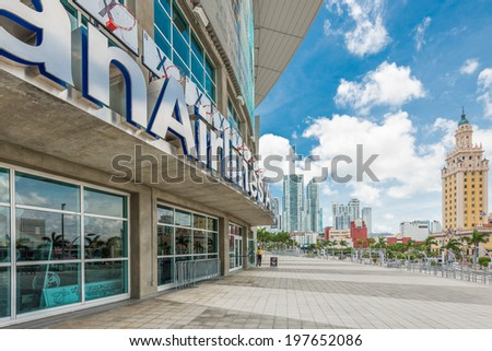 MIAMI,USA - MAY 27,2014 : The American Airlines Arena, home of the Miami Heat professional basketball team with a view of Downtown Miami - stock photo