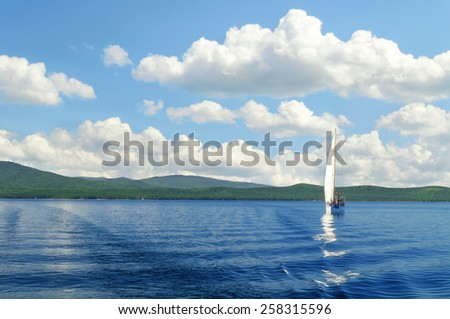 MIASS,RUSSIA - AUGUST 13, 2009.Summer landscape of Turgoyak Lake, Southern Urals (soft focus processing)