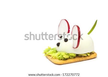 Mice made with eggs, pepper, radish and avocado paste - stock photo