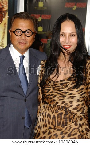 "Michael Chow and wife Eva at the Los Angeles Premiere of ""Rush Hour 3"". Mann's Chinese Theater, Hollywood, CA. 07-30-07 - stock photo"