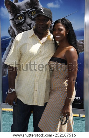 """Michael Clarke Duncan and Omarosa at the Los Angeles Premiere of """"Cats & Dogs: The Revenge Of Kitty Galore"""" held at the Grauman's Chinese Theater in Los Angeles, United States on July 25, 2010. - stock photo"""