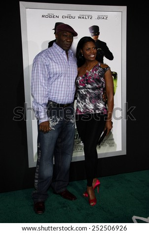"""Michael Clarke Duncan and Omarosa at the Los Angeles Premiere of """"The Green Hornet"""" held at the Grauman's Chinese Theater in Hollywood, California, United States on January 10, 2010.  - stock photo"""