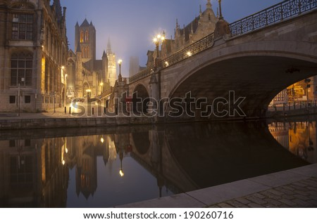 Michael s bridge and city belfort of Gent in fog of early morning. Belgium, April 2014. - stock photo