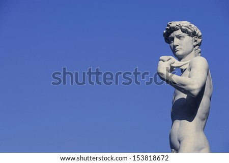 Michelangelo's David in the Piazza Della Signoria in the historical Renaissance city of Florence, Tuscany, Italy./ David in blue sky - stock photo