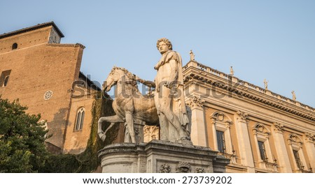 Michelangelo's Piazza del Campidoglio - one of the statues of the Dioscuri on sunset. View 2. Rome. Italy. - stock photo