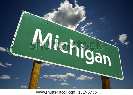Michigan Road Sign with dramatic clouds and sky. - stock photo