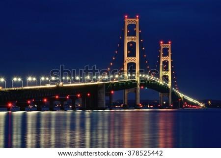 Michigan's Mackinac Bridge Lit at Night - stock photo
