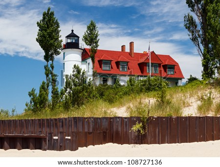 Michigan's Pointe Betsie Lighthouse with Beach Seawall - stock photo