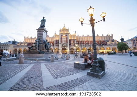 Mickiewicz Monument and Cloth's Hall on the Krakow market square - stock photo