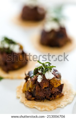 Micro Bruschetta of Chocolate Eggplant Caponata with Chocolate Balsamic Vinegar & Crumbled Haystack Mountain Goat Cheese appetizers.