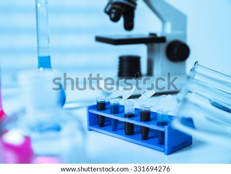 Micro tubes with biological samples in laboratory for DNA analysis. - stock photo