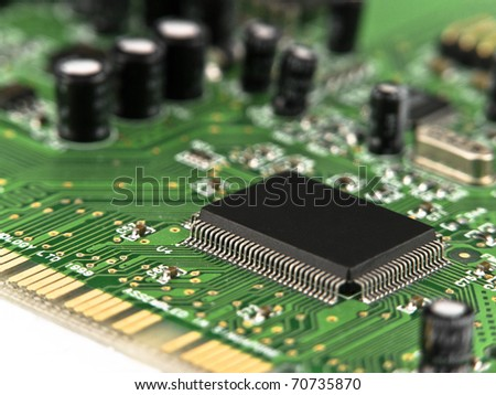Microchip on printed circuit board (PCB) - stock photo
