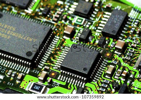 Microchips on a circuit board - stock photo