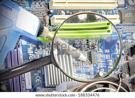 Microcircuit being fixed with soldering iron - sharp a component onto a printed circuit board while  - stock photo