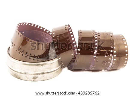 Microfilm strip in metal case isolated