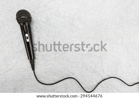 Microphone and cable on white background - stock photo