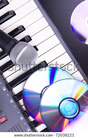 Microphone and electronic keyboard. Closeup on table