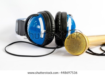 Microphone and headphone on white background.