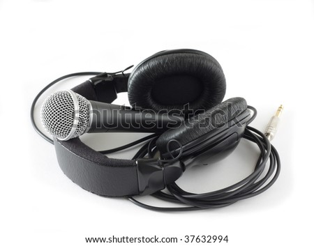 microphone and headphones over white - stock photo