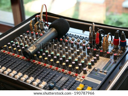 Microphone and Mixing Board - stock photo