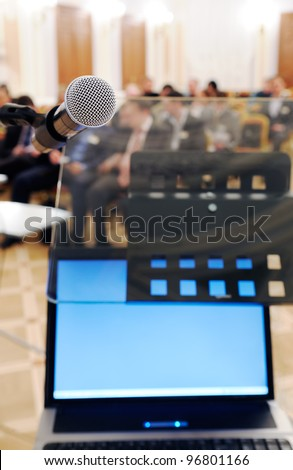 Microphone and notebook at the Conference. - stock photo