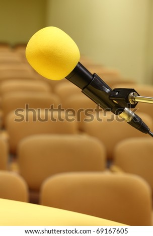 Microphone at conference - rows of empty seats texture - stock photo