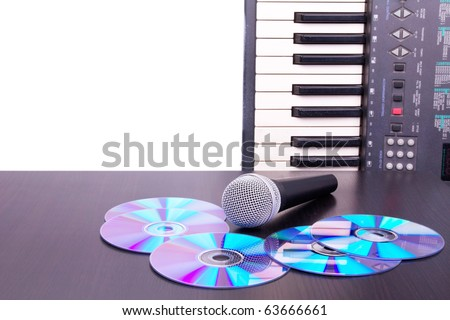 Microphone,cd discs and electronic keyboard, Closed-up on black table - stock photo