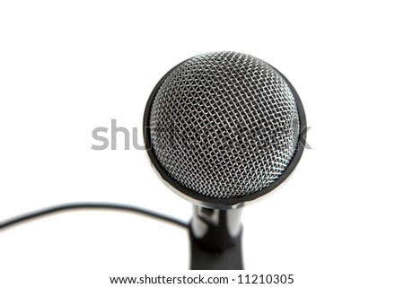 Microphone close-up over white. Front focus - stock photo