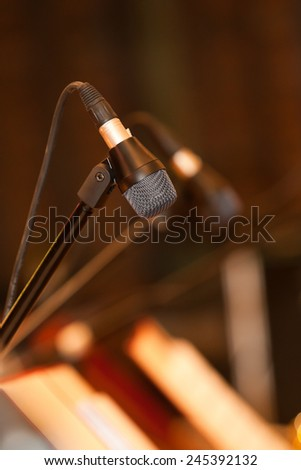 Microphone closeup standing on the stage  - stock photo
