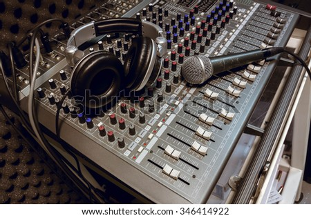 microphone ,headphone on sound mixer background. - stock photo