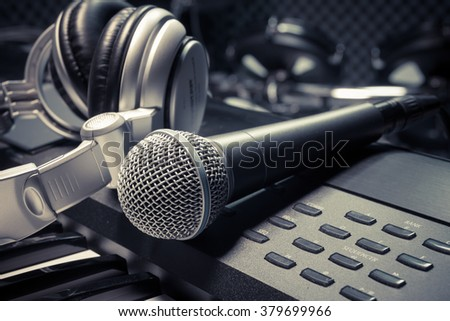microphone,headphone piano background. - stock photo