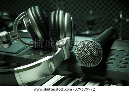 microphone,headphone piano background. - stock photo